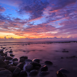 Sunset Hunter by Teddy Winanda - Landscapes Sunsets & Sunrises ( clouds, sky, nature, colorful, sunset, cloudscape, long exposure, beach, rock formation, ocean view, longexposure )