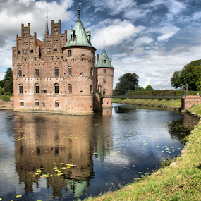 Egeskov Castle  (Denmark) by Gianluca Presto - Buildings & Architecture Homes ( home, nobody, old, reflection, water reflection, europe, reflections, travel, house, historic, sky, ancient, towers, cloudy, homes, travel locations, water, clouds, houses, hdr, egeskov, lake, old building, old castle, tower, castle, denmark, bridge, historical, medieval, travel photography,  )