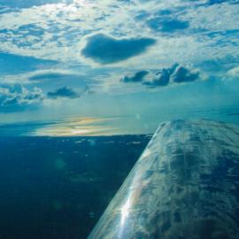 In the Clouds by Myra Brizendine Wilson - Transportation Airplanes ( clouds, flying, orange skies, mooney flying, fl, sky, airplane wing, sunset in clouds, sunset, blue skies, mooney, sun, airplane flying,  )