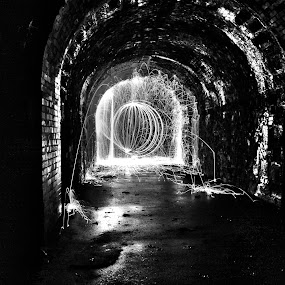 Tunnel Ball by Graeme Garton - Abstract Light Painting ( ball, b&w, light ball, light painting, wire wool, black and white, sparks, tunnel )