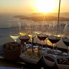 Sunset wine by Sian Arulanantham - Food & Drink Alcohol & Drinks ( wine, wine tasting, glasses, sunset, greece, sea, view, olives, santorini )