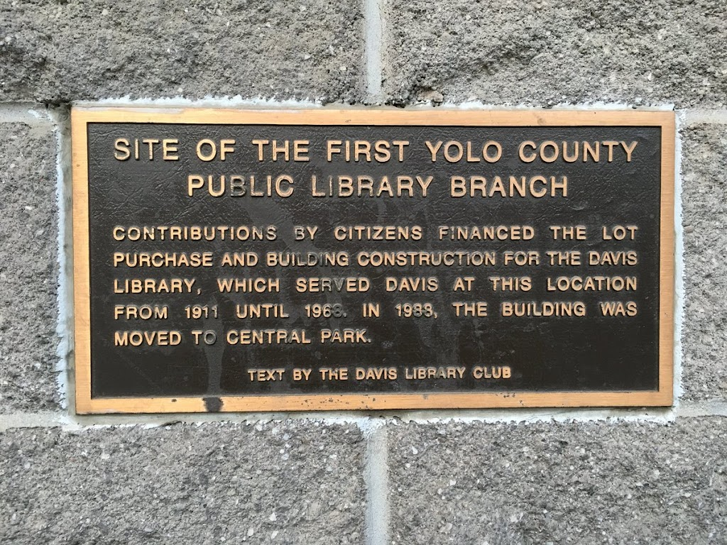 SITE OF THE FIRST YOLO COUNTY PUBLIC LIBRARY BRANCH CONTRIBUTIONS BY CITIZENS FINANCED THE LOT PURCHASE AND BUILDING CONSTRUCTION FOR THE DAVIS LIBRARY, WHICH SERVED DAVIS AT THIS LOCATION FROM ...