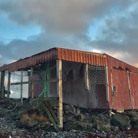Built at the beach by Stefán Margrétarson - Buildings & Architecture Public & Historical ( clouds, building, old, sky, beach, house, stones, rocks )