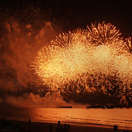 Explosive Beach by Andrew Sledmore - Landscapes Beaches ( sand, watching, sea, fireworks, night, beach, glow,  )