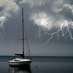 calm before the storm by David Pratt - Landscapes Weather ( lightning, waterscape, storm, boat, weatther )