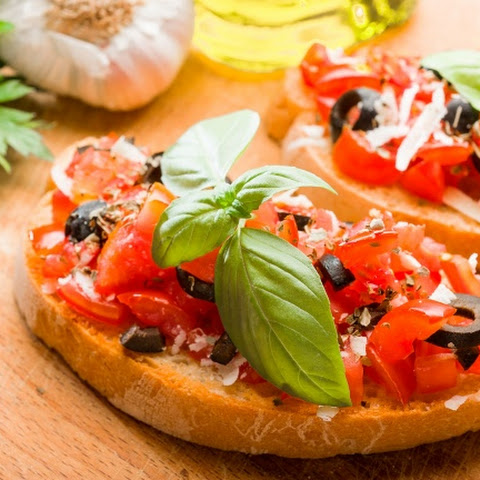 Bruschetta — Italian hot sandwiches with tomatoes and cheese