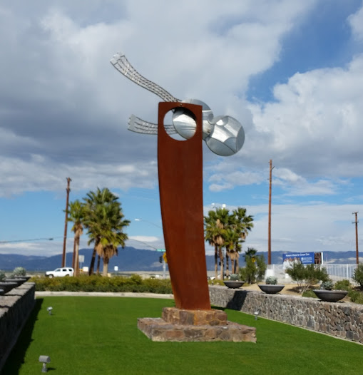 This large abstract work serves as an iconic entry sculpture for the Escena neighborhood in Palm Springs, California.