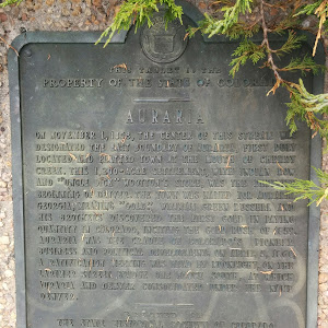 --THIS TABLET IS THE PROPERTY OF THE STATE OF COLORADO-- AURARIA On November 1, 1858, the center of this stream was designated the east boundary of Auraria, first duly located and platted town at the ...