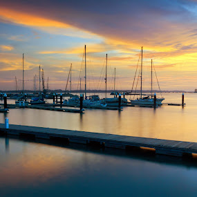 Harbour at sunset by Macbrian Mun - Landscapes Waterscapes ( skyline, harbor, silhouette, yacht, yellow, transportation, beach, travel, recreation, dock, johor, sky, marina, orange, twilight, malaysia, dusk, vacation, johore, bay, view, nautical, port, reflection, ship, harbour, ocean, beauty, landscape, coast, sun, tranquil, transport, asia, evening, clouds, water, boats, beautiful, sea, scenic, sailboat, boat, red, color, blue, sunset, outdoor, cloud, summer, fishing )