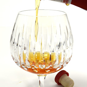 Pouring Grand Marnier by John Ogden - Food & Drink Alcohol & Drinks ( alcohol, pouring, cognac, grand marnier, snifter )