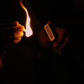 timing by Pramodh Ramesh - Abstract Fire & Fireworks ( sinlge light, indoor, hands, matchstick, dark, matchbox, fire )