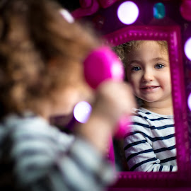 Little Vanity by Mike DeMicco - Babies & Children Child Portraits ( reflection, innocent, little, cute, pretty, portrait, eyes, mirror, lights, love, child, curly, blonde, vanity, sweet, girl, blue, curls, adorable, smile, hair )