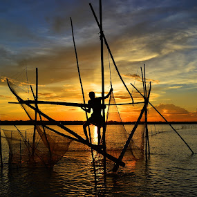 FISHING AT SUNSET 2 by Dipankar Singha - Landscapes Sunsets & Sunrises