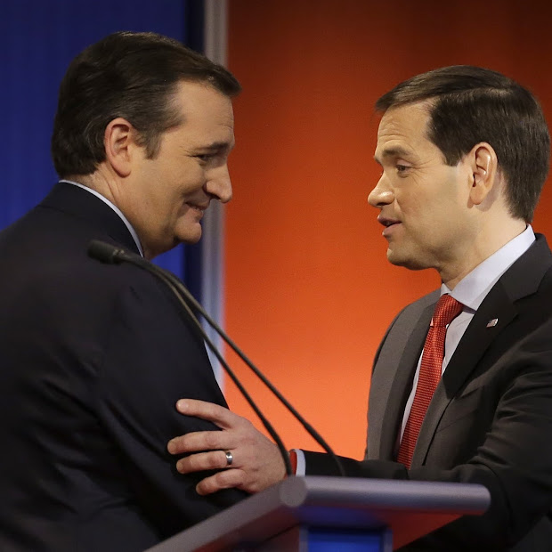 Republican presidential candidates, Sen. Ted Cruz, R-Texas and Sen. Marco Rubio, R-Fla. talk after a Republican presidential primary debate, Thursday, Jan. 28, 2016, in Des Moines, Iowa. (AP Photo/Chris Carlson)
