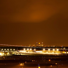 MSP, Minneapolis skyline with airplane landing. by Scott Knight - Landscapes Travel (  )
