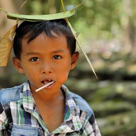 Leafs by Tomasz Budziak - Babies & Children Child Portraits ( asia, child portrait, boy, cambodia, portrait )