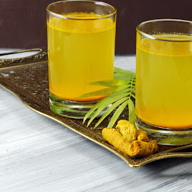 Turmeric drink by Dipali S - Food & Drink Alcohol & Drinks ( lhoney, himalayan salt, spicy healthy haldi or turmeric, and lemon antioxidant drink with lemon on a moody background. )