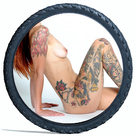 Girl in the Tyre by DJ Cockburn - Digital Art People ( studio, torso, art nude, model, auburn, nude, circle, bicycle tyre, sitting, woman, redhead, tattoo, lucerne )