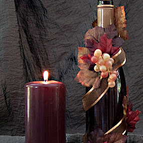 Relaxing with a Bottle of Wine by Sherry Hallemeier - Artistic Objects Still Life ( wine, lit, cork, fall colors, still life, beautiful, fine art, bottle, leaves, photography, candle, grapes, fall, wine bottle, lighted,  )