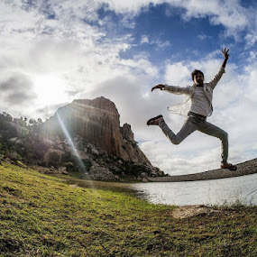 Jumping High by Mithun Kümär - People Portraits of Men ( water, bangalore, hill, fisheye, mountain, green, sunflares, jump, away, india, high, rocks, boy, light, friend, man, shirt )