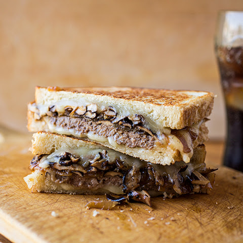 Bistro-Style Patty Melt with Havarti Cheese, Caramelized Onions and Sauteed Shiitake Mushrooms on Toasted Sour Dough Bread