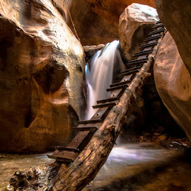 Kanarra Falls by Cameron Knudsen - Landscapes Deserts ( knudsen outdoors, cameron knudsen, waterfall, river trecking, kanarra canyon, timeless moments photography, travel, landscape, slow shutter speed, knudsen photography, slot canyon, knudsen, nature, national geographic, utah, utah camping, utah hiking, long exposure, travel photography, river, relax, tranquil, relaxing, tranquility )