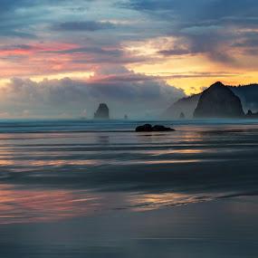 Cannon Beach Sunset by Eric Hanson - Landscapes Sunsets & Sunrises ( clouds, haze, oregon, pastel, fog, haystack rock, sunset, cannon beach, pacific, northwest, beach, mist )