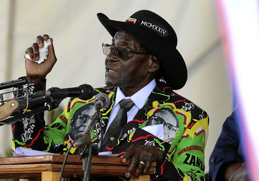 Zimbabwean President Robert Mugabe speaks to supporters gathered to celebrate his 93rd birthday at Matopas near Bulawayo on February 25 2017. Picture: REUTERS