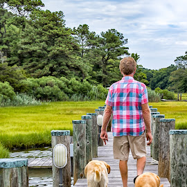 A Walk on the Dock by Carol Ward - People Street & Candids ( dogs, waterscape, south point md, docks, man )
