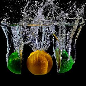 Between Us.. by Pete G. Flores - Food & Drink Fruits & Vegetables ( clear, autofocus, dip, splash, food, green, drop, otip, crystal, otep, lemon )