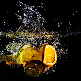 Oranges by Dumitru Doru - Food & Drink Fruits & Vegetables ( water, orange, vitamins, splash, food, fruits, light, black )