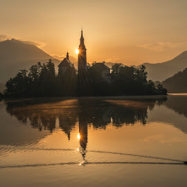 Peaceful Sunrise at Lake Bled by Aleš Krivec - Landscapes Sunsets & Sunrises ( water, mountains, nature, church, fog, beautiful, white, bled, castle, lake, mist, island )
