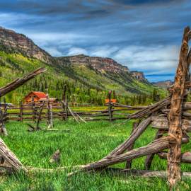 Western Solitude by Tom Weisbrook - Landscapes Mountains & Hills ( hillside, fence, ranch, mountains, peaceful, corral, durango, rocky mountains, colorado, solitude, split rail fence )