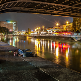 Homeless.. by Jesus Giraldo - City,  Street & Park  Night ( lights, wien, concept, colors, art, street, poor, night, bridge, sleep, man, city )