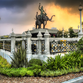 Changwattana Monument by Phil Hanna - Buildings & Architecture Statues & Monuments ( bangkok, statue, sunset, elephant, thailand, chalerm changwattana, storm clouds )