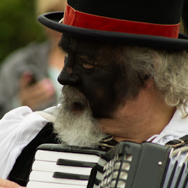 Playing by Marc Steele - People Musicians & Entertainers ( countryside, uk, morris, wellow, may day, instrument, black pig border morris, rural, pig, country, england, bank holiday, event, nottinghamshire, dancer, black, acordion )