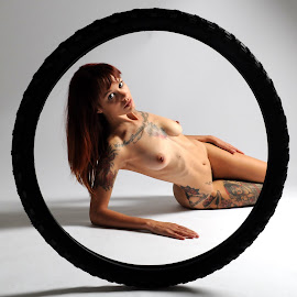 Lucerne in a Tyre by DJ Cockburn - Nudes & Boudoir Artistic Nude ( studio, bicycle tyre, art nude, model, lying, auburn, nude, woman, redhead, circle, tattoo, lucerne )