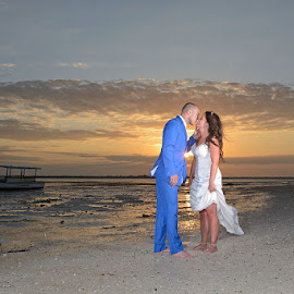 Sunset Kiss by Andrew Morgan - Wedding Bride & Groom ( love, kiss, zanzibar, sunset, wedding, destinationwedding, happiness, beach )
