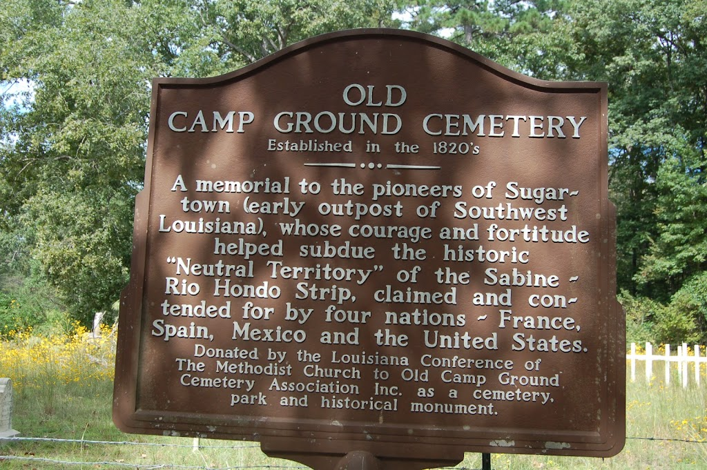 A memorial to the pioneers of Sugartown (early outpost of Southwest Louisiana), whose courage and fortitude helped subdue the historic