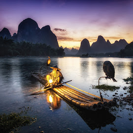 Ethereal Night  by Aaron Choi - Landscapes Travel ( hills, old, mountain, li river, karst, travel, xingping, chinese, guangxi, asian, lantern, mountains, nature, asia, old man, fisher, man, china, cormorant, tourism, li, yangshuo, sunset, night, fishing, guilin, fisherman, river )
