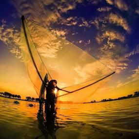 Shrimp catcher by Mc Pujiyanta - Landscapes Sunsets & Sunrises ( sunset, silhoutte, fishing, sunrise, landscape, human )