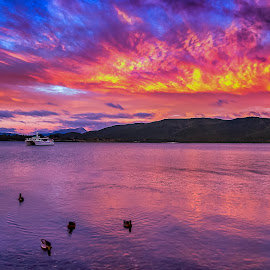 Sunset over the Lake by Keith Walmsley - Landscapes Sunsets & Sunrises ( water, clouds, mountain, nature, sunset, landscape, natural )