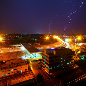 Road into lightning gateway by Tan  Kian Yong - City,  Street & Park  Vistas ( lights, lightning, highway, night, storm, city )