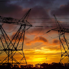Electrical Sunset by Adriette Benade - Landscapes Sunsets & Sunrises ( cloud formations, clouds, power cable, silhouette, sunset, south africa, sunrays, silhouettes, power, cloudscape, power plant, sunrise, sunlight )