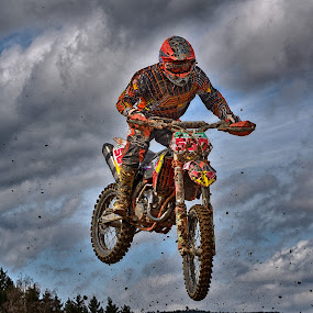 Dropping Down by Marco Bertamé - Sports & Fitness Motorsports ( clouds, orange, speed, number, yellow, race, noise, jump, flying, red, motocross, clumps, air, high, 587, dropping down,  )