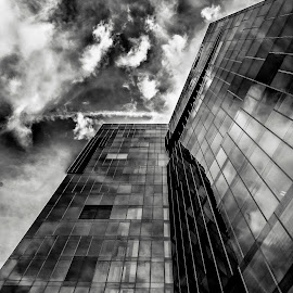 Bonded by Paulo Gonçalves - Buildings & Architecture Other Exteriors ( clouds, mirrors, building, black and white, cloudscape, cityscape, spain, city, mirror, mirrored reflections, sky, buildings, espanha, bonded, barcelona )