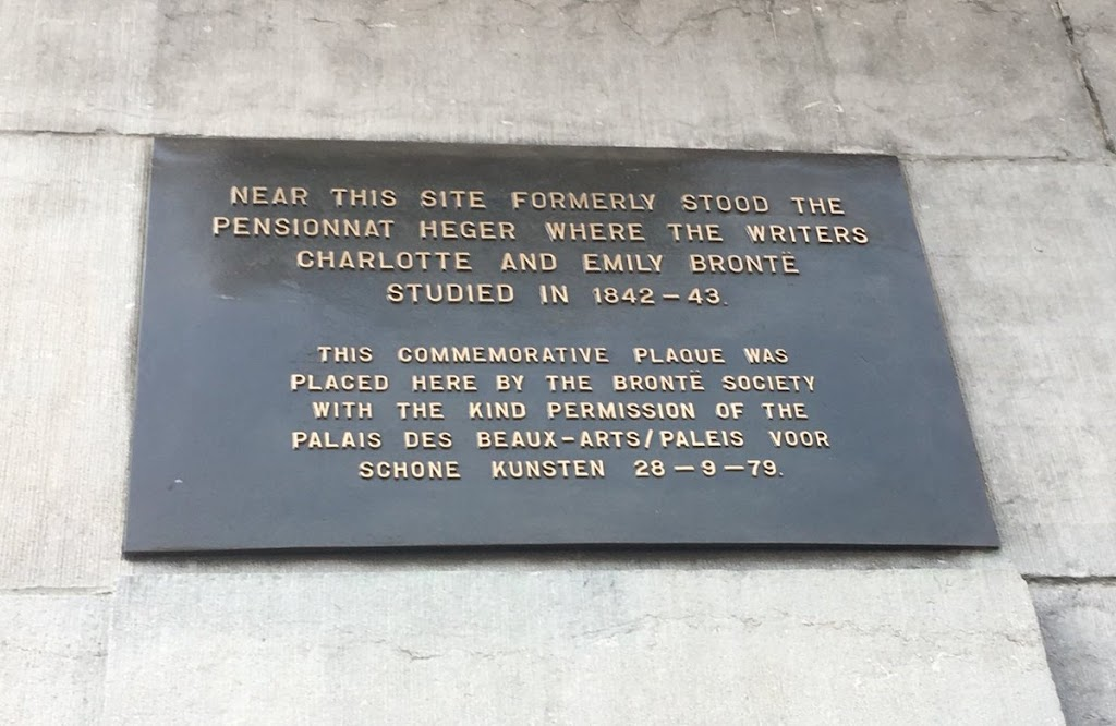 NEAR THIS SITE FORMERLY STOOD THE PENSIONNAT HEGER WHERE THE WRITERS CHARLOTTE AND EMILY BRONTE STUDIED IN 1842-43 THIS COMMEMORATIVE PLAQUE WAS PLACED HERE BY THE BRONTE SOCCIETY WITH THE KIND ...