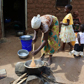 Cooking  by Cyndi Rosenthal - People Street & Candids ( rice, outdoors, cooking, tribal, cooking rice africa children woman )
