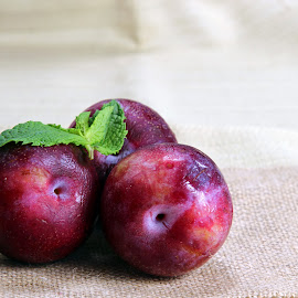 Two plums and mint by Dipali S - Food & Drink Fruits & Vegetables ( juicy, fruit, purple, health, snack, plum, berry, organic, tasty, sweet, fresh, food, ripe, summer, healthy, antioxidant, vegetarian, jam, vitamin, natural, gourmet, closeup, dessert )