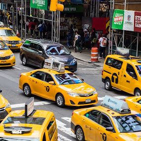 New York Times Square Traffic by Thomas Shaw - City,  Street & Park  Street Scenes ( cabs, glass, city life, reflection, city, street scene, taxi, yellow, downtown, new york, transportation, cars, 2018, crosswalk, new york city, street, nyc, times square, street photography, traffic )